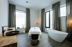 Flexible Wooden Detail for Your Hotel Interior Design : White Bathtub Design With Grey Curtain In Hotel Interior Design