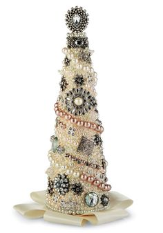 Jewelry Tree - love this! But do I have enough costume jewelry to make one? And will one look okay all by itself? I need a mini forest! Time to shop at Goodwill.