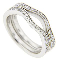 Round diamonds are set in the tops of these 14K white gold antique style curved wedding bands. The diamonds are graduated in size to complement the curves of the rings. Each ring measures 3.3mm in width. The rings are photographed here with R2140-PL (sold separately). Size: 6 1/2. We can resize. The bands are frequently purchased as a set for $900.00 but they are also available individually for