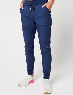 Hybrid Jogger Pant in Estate Navy Blue is a contemporary addition to women's medical scrub outfits. Shop Jaanuu for scrubs, lab coats and other medical apparel. scrubs Hybrid Jogger Pant in Estate Navy Blue - Medical Scrubs Cute Nursing Scrubs, Cute Scrubs, Nursing Clothes, Scrubs Outfit, Scrubs Uniform, Jogger Pants, Joggers, Navy Blue Scrubs, Ceil Blue Scrubs