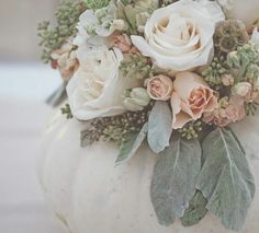 I LOVE the idea of scattering tiny white pumpkins throughout our wedding for a bit of whimsy and romance! Check out these 10 Pumpkin Wedding Decor Ideas.