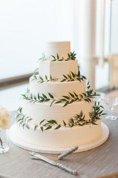 Organic + minimalist leaf accented wedding cake: http://www.stylemepretty.com/texas-weddings/dallas/2016/01/04/organic-traditionally-elegant-wedding-in-dallas/   Photography: Heather Hawkins - http://heatherhawkinsphoto.com/