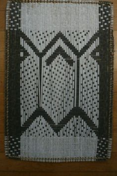 Losa Mat from the Mbole people in D.R. Congo. 56 x 36 cm