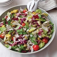 Big Italian Salad | Part green salad part antipasto salad, this recipe combines lettuce, celery, onion, peperoncini, olives and cherry tomatoes—all tossed in a dressing made with olive oil, vinegar and a little mayonnaise.