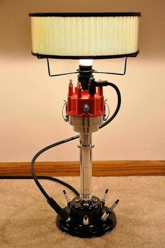 These lamps are built one at a time by a true car guy. They are built using real car parts. It features a billet car distributor. The base is made from a car Garage Furniture, Car Part Furniture, Automotive Furniture, Automotive Decor, Bench Furniture, Furniture Design, Furniture Plans, Kids Furniture, Automotive Group