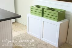 I like the spray painted craft store crates for extra storage; IKEA Besta cabinets below