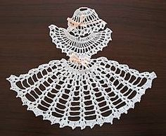 Free Crinoline Lady Motif Pattern to make.  This handy motif may be applied to a variety of projects - towels, sheets, pillowcases, or as a doily.
