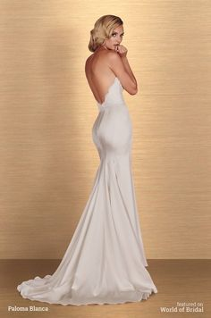 Paloma Blanca Spring 2016 French Alençon Lace and Paloma Satin Wedding Dress. Strapless sweetheart lace bodice. Multiple shaped seams along back of fit and flare satin skirt.