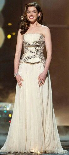 Anne Hathaway-Her 40's-remeniscent dress and especially her hair make her look like Judy Garland! Gorgeous!