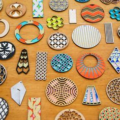 check this girl out! she makes seriously awesome laser cut earrings out of sustainable materials!