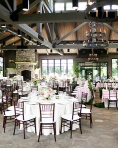 Venue in Bloom  Pink-and-white striped table linens brightened up the rustic reception space, while compotes of cascading floral arrangements provided an overgrown garden feel.