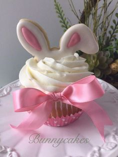 """Easter cupcakes with """"Bunny ear"""" cookie topper made by Bunnycakes cupcakes vanilla Easter Bunny Ear Cupcakes Fondant Cupcakes, Oster Cupcakes, Wedding Cakes With Cupcakes, Fun Cupcakes, Birthday Cupcakes, Cupcake Cakes, Cupcake Ideas, Spring Cupcakes, Mocha Cupcakes"""
