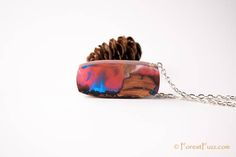 This #stunning #jewelry piece just became available on #forestfuzz Symmetric necklace of resin and wood fusion combined in magic symphony of nature and color on a silver color chain - love pendant by ForestFuzz Discover #resinart #resinjewelry #woodandresin #woodresin #forestfuzz #wood #resin #jewelry #handmade #inspiration take this #handmadejewelry #necklace from #forest #fuzz and add it to #jewelry #diy #resinart #tornado #whirlpool #moonlight #moon #epoxy #red #bluesky #collections…