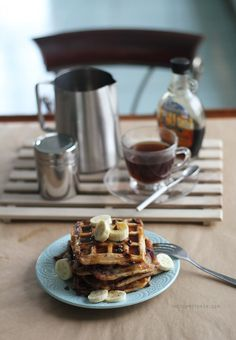 Peanut Butter Banana Waffles with Chocolate Chip Recipe | The classic peanut butter-banana combo in waffle form, made more special by swirls of melted chocolate chips! Recipe on the blog :)