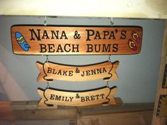"Custom carved signs. Hand routed personalized wood signs.   ""Nana  Papa's Beach Bums""  With the grandkids names listed on the banners below.   Visit my Etsy shop for more pictures."