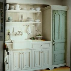Cottage kitchen, small 10x12, like the white cabinets, wood planked wall, shelves, probably not so lucky to find the curved cabinet doors for the refrigerator, sigh,