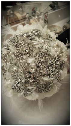 Brooch bouquet... get a brooch from my mom, his mom, our grandmas, aunts, sisters, cousins, etc.... to be a part of the bouquet.  Everyone feels part :)