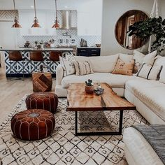 I love to travel, but DAMN it feels good to be home. 💕🏠💕 Built by: cremdevelopment Designed by: lancasterinteriors Custom table by: a_carpenters_son Poufs, Rug & Mirror: luluandgeorgia Tulum Tile: riadtile Custom Puppy Plates: rdkartwork ❤ Boho Living Room, Home And Living, Moroccan Decor Living Room, White Couch Living Room, Cozy Living, Small Living, Brick Wall In Bedroom, Tile Living Room, Earth Tone Living Room Decor