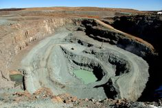Picture of the Letseng mine in the South African Kingdom of Lesotho owned by Gem Diamonds and the government of Lesotho. The mine is famous for its large diamonds. Out Of Africa, White Stone, Great Places, South Africa, Minerals, Travel Destinations, Gem Diamonds, Tours, Gem Stones