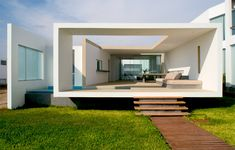 lima-based artadi arquitectos have finished the 'house in las arenas', a private beach-side residence 100 miles south of lima, peru