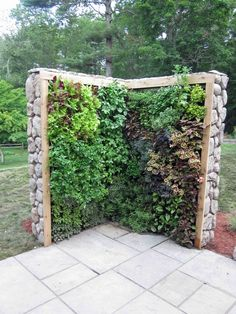 Herb & Salad Wall: I think I could build something similar with gutters