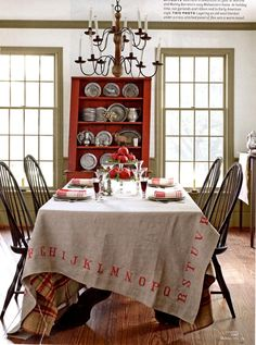 DIY tablecloth - stencil on drop cloth or burlap - layer on top of wool blanket for contrast