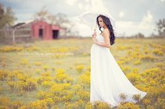 stunning natural shot love the barn in the background, love the parasol and white flowy dress so elegant yet au natural in the field