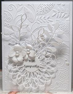 Ive been wanting to create a monochromatic card for a while, but wasnt sure what color I was going to use. Today I want to share a white on white card using only the color white.The entire card is made from Bazzill white cardstock.I cut the base to an 8 1/2 x 10 dimension that when folded in