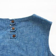 Since today is #tbt I thought I'd share an old #diy. This is a basic chambray shell I made about 4 years ago. My favorite part are the button tabs at the back neck. #craftfromthepast #diyfashion