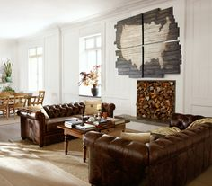 leather sofas.  rustic and bright.  white wood paneled walls.  wood stack in fireplace.