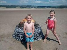 Family photographs kids with 'beach buoy', turns out it was WWII bomb ~ Photography News