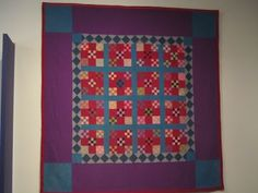 Nine patch in nine patch Amish quilt.