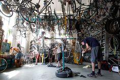 Vienna, Austria: People repair bikes at the WUK self-help bicycle workshop