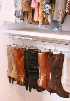 Using pants hangers to hang boots. Duh!  Why didn't I think of this!  I think I would use  something to protect the leather from the clip though.