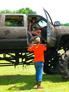 Cute southern gentleman helping his girlfriend out of his lifted truck