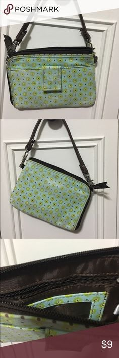 Thirty one Wristlet Cute Wristlet with outside Velcro strap closure, inside ID slot and card slots, inside zip pocket, removable leather strap. 90 degree zip closure. Light turquoise and brown trim thirty one Bags Clutches & Wristlets