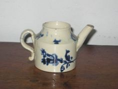 ANTIQUE CHILD MINIATURE TEA POT no lid COBALT PEARLWARE CIR GEORGIAN PERIOD   HT  4 CMS      DISPLAY CONDITION there is a shallow nib to the outer rim  the handle hbeen broken into two pieces and has an old glued repair to it £59   BIN