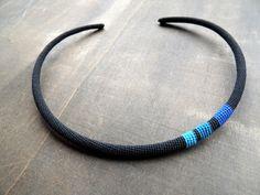 Minimalistic crochet choker in black and a tiny bit of blue.