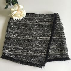 """NWT Sam Edelman Asymmetrical Skirt NWT Black and white jacquard highlighted with silvery threads fashioned into a faux wrap skirt. Back zip.  Fully lined.  Black fringe lend a modern boho vibe. 15"""" waist, 15"""" length including fringe.  Last photo depicts same skirt, different pattern. Sam Edelman Skirts Mini"""
