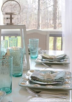 Beach Themed Table Setting Tablescape With Lighthouse Lantern and Shell, Sailboat Dishware