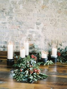 Berry and Greenery Garland with Pillar Candles | Geneoh Photography | http://heyweddinglady.com/warm-and-cozy-winter-wedding-with-a-little-holiday-sparkle/