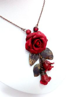 Roses - pendant handmade from polymer clay.  Exquisite handmade jewelry in autumn politrila . A great addition to the evening image. Exclusive