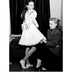 Julie Andrews aged 12 getting fitted for her dress.