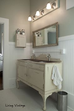 Custom bathroom vanity from an old piece of furniture - we already have a buffet like this with a bad leg.. would be a great option to use it as a vanity...