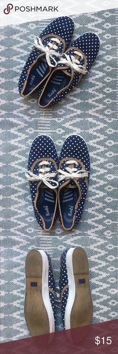 Ked's sneakers Adorably classic navy ked's with white polka dots and tan trim. Only worn outside twice. Perfect with a pair of cuffed jeans or shorts for summer! Keds Shoes Sneakers