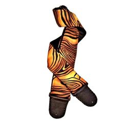 The stage is your territory when you wear this incredibly lifelike Bengal tiger stripe artisan handmade guitar strap. The front fabric of the guitar strap is thick, soft suede cloth printed with classic black Bengal tiger stripes. The pelt is dappled with realistic shades of black, brown, tan, and yellow that perfectly mimic how a tiger's fur looks as the sunlight filters through the jungle canopy. Sprinkled sparsely throughout the entire surface of the guitar strap are bits of tiny ...