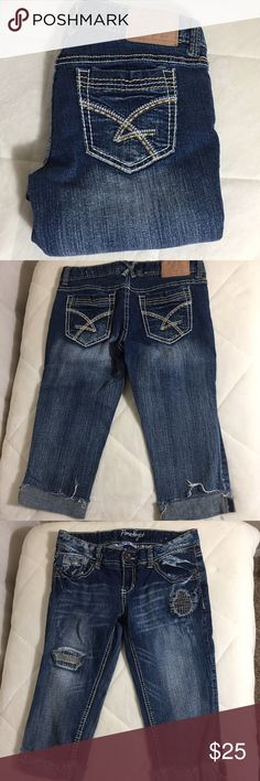 """Amethyst Capris Size 5 Embroidered in two colors on the back pockets Front distressing is patched and sewn over, in two area Cuffed bottoms  98% cotton 2% spandex Machine wash cold and tumble dry low  Approximate measurements Waist 154"""" Rise 7"""" Inseam 16"""" Leg opening  6.5"""" amethyst Jeans"""