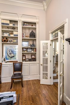 Books and artwork fill this Ocean Springs, MS home library with treasures. Ocean Springs, Libraries, Yoga Poses, Offices, Home Office, Ms, Fill, Interior Design, Artwork