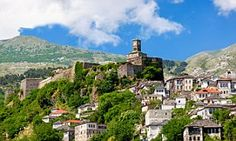 The Daily Mail's Thomas W. Hodgkinson explored the Albanian town of Gjirokaster with his wife and infant son, a stunning spot just an hour's swim from the Greek island of Corfu - and much cheaper.