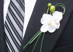 a boutonniere of white phalaenopsis orchids with bear grass. Prom Flowers, Fake Flowers, Wedding Flowers, Beautiful Flowers, Exotic Flowers, Flowers Garden, Purple Flowers, Orchid Boutonniere, Corsage And Boutonniere